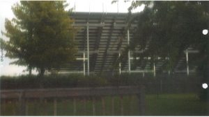 Picture included in brief before the Illinois Supreme Court, depicting the view of the Plaintiff's backyard following the school's construction of its new bleachers