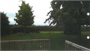 Picture depicting the view from the Plaintiff's backyard prior to the construction of new bleachers